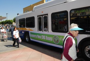 Commerce residents got a view of the new compressed natural gas bus at a shopping center bus stop. (Photo courtesy of the city of Commerce)