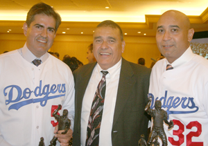 Left, Henry Dominguez Vice President of sales for Anheuser-Busch Southwest,  far right, Daniel E. Jinney, Vice President of Operations at State Farm California Office.  Center is Danny Hernandez President, Hollenbeck Police Business Council and the Inner City Games. (EGP Photo by Fred Zermeno)