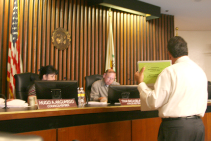 City Manager Jorge Rifa addresses council during a budget meeting. (EGP Photo by Elizabeth Chou)