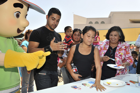 Disney's Handy Manny (left), Actor Wilmer Valderrama (middle left) and County Supervisor Gloria Molina (right) attended the inauguration of the a new child development center located inside the East Los Angeles Civic Center on Aug. 1.