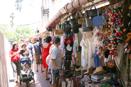 For years, a wide variety of tourists and local residents have made afternoon stops at Olvera Street. Long Caption: Millions of visitors have stopped by Olvera Street for the past few years. Now, L.A City officials are calling for merchants to pay the market price to rent a space in order to cover the nearly $1 million in losses to the general fund caused by El Pueblo. Councilmember Huizar says that El Pueblo should pay for itself. (EGP Photo by Gloria Angelina Castillo)
