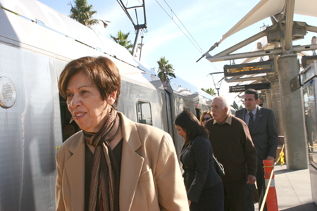 RAC Co-chair Diana Tarango smiles as she prepares to ride the Gold Line light-rail she fought long and hard to bring to East LA. (EGP photo by Gloria Angelina Castillo)
