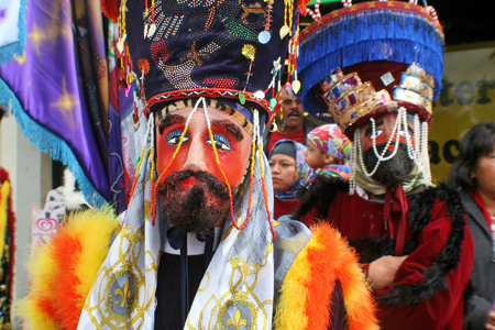 "Thousands of Catholic faithful were on hand to experience the many colorful costumes such as these from a Resurrection Church group at the mass and procession on Dec 6. The annual celebration recalls the miraculous apparitions of the Virgin Mary to Saint Juan Diego at Tepeyac, Mexico in December 1531, where she left her image on his ""tilma"" or cloak. (EGP Photo by Fred Zermeno)"