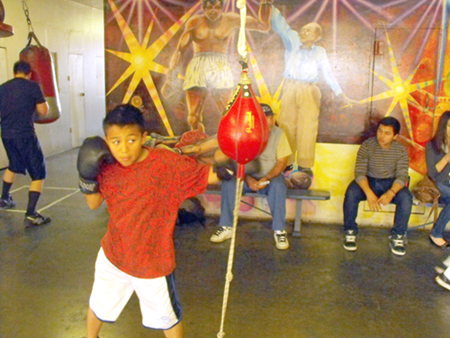 "Isaiah Torres, 10, put in his final work on a speed bag at the LAYAC on April 30. ""I wanna grow up confident, I wanna feel proud of myself,"" he said of his motivation to train to be a boxer. (EGP photo by Paul Aranda, Jr.)"