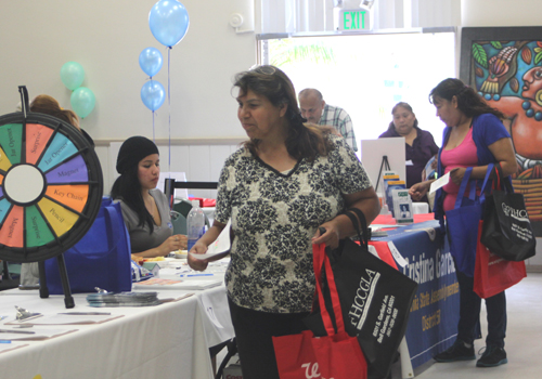 Bell Gardens residents visited the nearly 50 booths from businesses and community groups at the Business and Community Expo on Saturday. (EGP photo by Nancy Martinez)