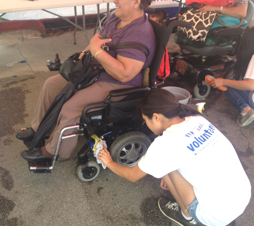 Volunteers gathered at the East Los Angeles Civic Center last week to provide entertainment and pampering to people in wheelchairs.(Courtesy of Famila Unida)