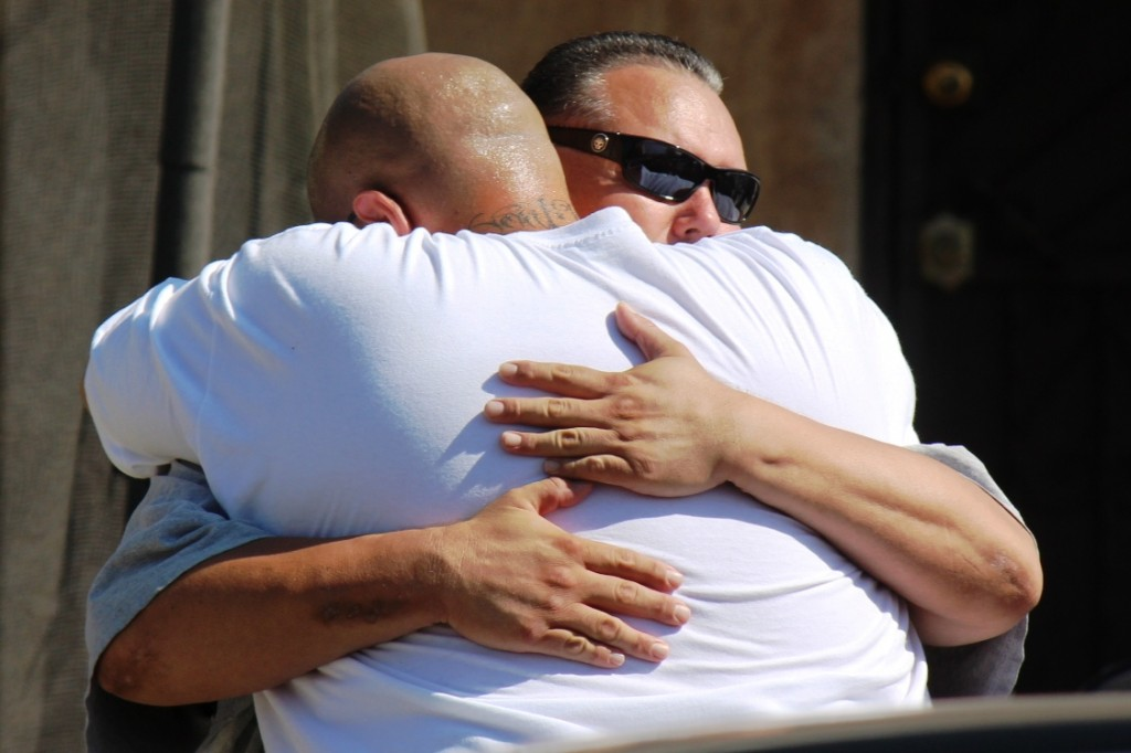 A nephew of David Lugo Sr., father of the 21-year-old killed, is consoled at the scene. (EGP photo by Fred Zermeno)