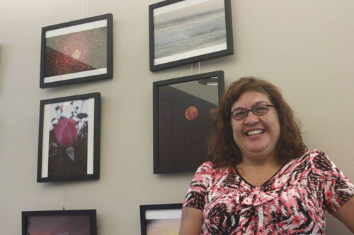 "Margie Ramirez, pictured, stands next to her exhibit ""Photos to Cherish"" on dislay at the Monterey Park Bruggemeyer Library. (EGP photo by Nancy Martinez)"