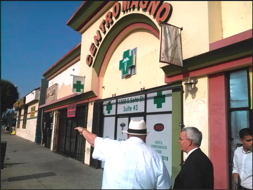 Members of Resurrection Church Neighborhood Watch gave Michael Colbruno, pictured right, a tour of medical marijuana dispensaries in Boyle Heights. (Courtesy of Resurrection Church  Neighborhood Watch)