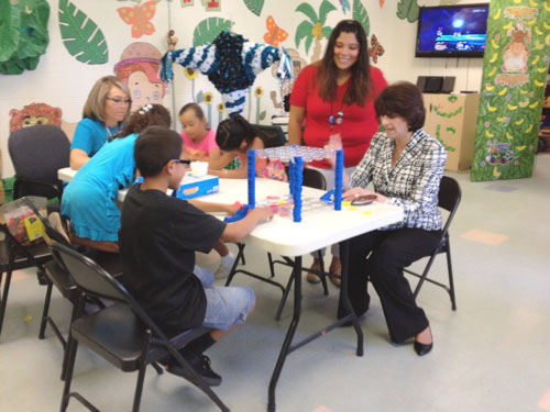 Rep. Lucille Roybal-Allard plays a board game with a young constituent at the Child Development Center in Nueva Maravilla. (Office of Congresswoman Lucille Roybal-Allard)
