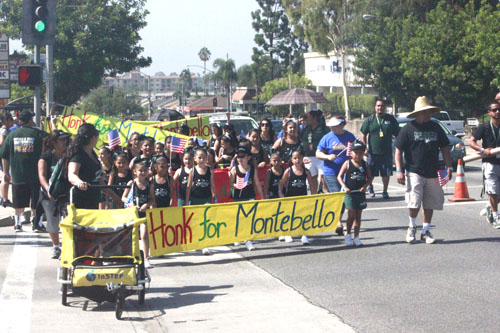The Montebello Indian Cheerleaders marched with other community groups down Montebello Boulevard last Saturday to create awareness about the importance of spending dollars locally.  (EGP photo by Nancy Martinez)