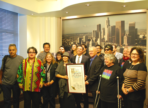 Prominent LA muralist pose with Councilmember Jose Huizar to memorialize the resolution that was passed.  (Courtesy of Councilmember Jose Huizar's Office)