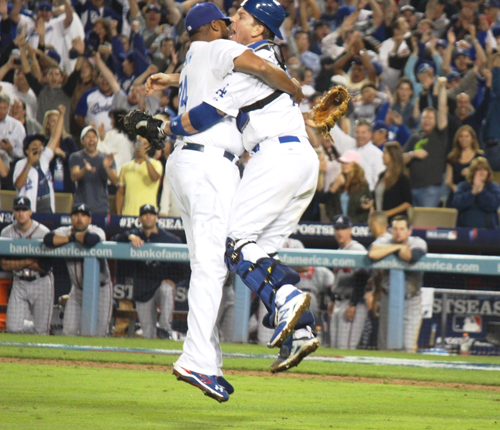 Dodger Pitcher Kenley Jensen and Catcher A.J. Ellis celebrate Monday as Jensen strikes out the side in the ninth inning to help the Dodgers advance to Friday's championship game. (EGP photo by Fred Zermeno)