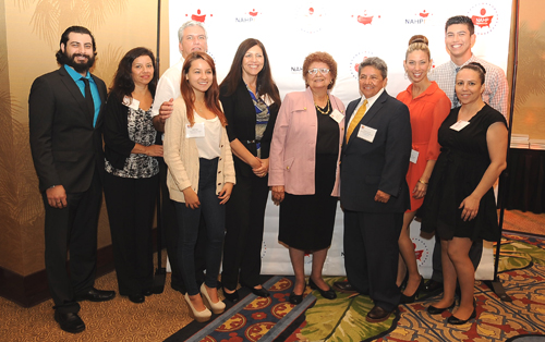 Eastern Group Publications/ EGPNews Publisher and CEO Dolores Sanchez (in pink), pictured  with her family, was honored by the National Association of Hispanic Publications as Latina Publisher of the Year. (Photo courtesy of NAHP)