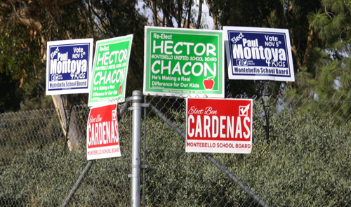 Candidates in elections in Bell Gardens and MUSD have been campaigning and putting up posters for months, leading up to the election next week.  (EGP photo by Gloria Angelina Castillo)