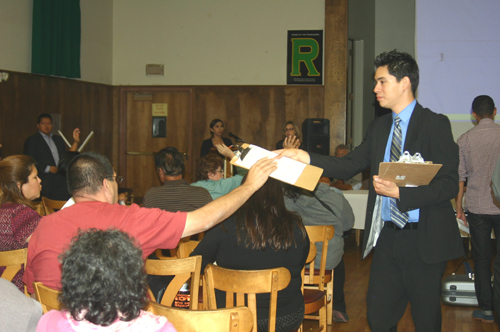 Dozens of residents on Monday night gathered to hear instructions on how to file a claim form and to ask questions. (EGP photo by Gloria Angelina Castillo)