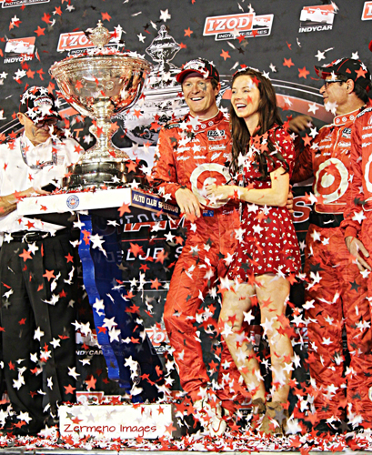 Scott Dixon celebrates 2013 Championship win with his team and wife Emma. (EGP photo by Fred Zermeno)