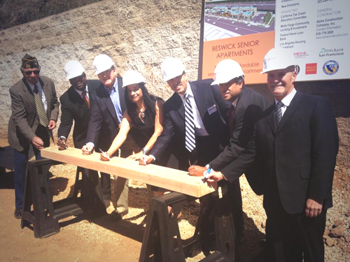 Construction of a housing complex for elderly homeless veterans began five months ago; project partners gathered last week for a 'beam signing' celebration at the facility. (Photo courtesy of ELACC)