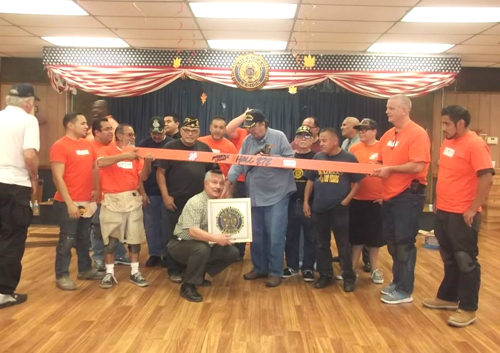 Veterans celebrate the new floor at the American Legion Post 272 in Montebello. (Courtesy of American Legion Auxiliary Unit 272)