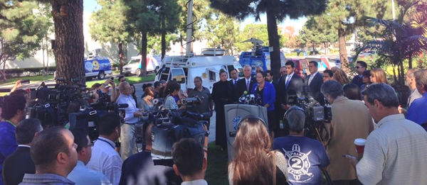 Assemblywoman Cristina Garcia, center in blue, speaks at a press conference in Bell Gardens Wednesday where she and local city officials asked Senator Ron Calderon to step down amid allegations of corruption.  (Courtesy of the Office of Cristina Garcia)