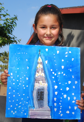 Scarlett Sanchez, 8, displays her painting of the Chrysler Building in New York, which was used in the 2014 Hathaway-Sycamores Children's Art Calendar. (Courtesy of Mary Kay Wilson)