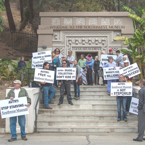 Activists protest in front of the closed Southwest museum. (Photo courtesy of Martha Benedict)