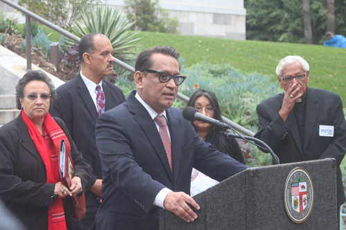 LA Councilmember Gil Cedillo, pictured, stands outside city hall call on President Obama to stop deportations of the undocumented. (EGP Photo by Fred Zermeno)