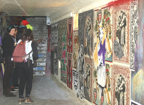 Visitors appreciate the art of the Cypress Village Tunnel Art Walk. (EGP photo by Jacqueline Garcia)