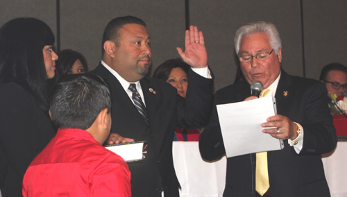 Montebello Councilmember Art Barajas, pictured left, holds his hand up as he is sworn into office by Pico Rivera Councilmember Bob J. Archuleta, during a special meeting at Quite Cannon. (EGP photo by Nancy Martinez)