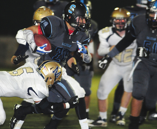 Salesian High School running back Felipe Meza (20) rips off a gain in Saturday's CIF Northeast Division championship game. Meza rushed for 149 yards to lead the Mustangs. (EGP Photo by Mario Villegas )