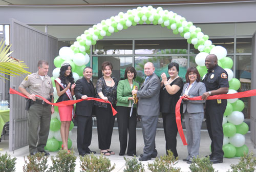Ribbon cutting opening Tuesday of Commerce's new Emergency Operations Center. Pictured left to right: L.A. County Sheriff's Dept.  Capt. Jim Wolak, Miss Commerce Shanese Perea, Councilman Ivan Altamirano, Mayor Pro Tem Lilia Leon, Congresswoman Lucille Roybal-Allard, Mayor Joe Aguilar, Councilwomen Tina Baca Del Rio and Denise Robles and Chief Michael Brown of the L.A. County Fire Dept. (City of Commerce)