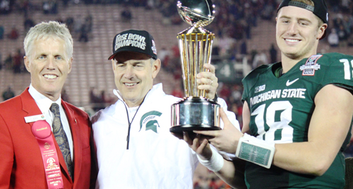 President of the Tournament of Roses Kevin with Michigan State coach, Mark Dantonio and offensive MVP, Quarterback Conner Cook celebrate as the 100th Rose Bowl Champions on January 1, 2014. (EGP photo by Fred Zermeno)