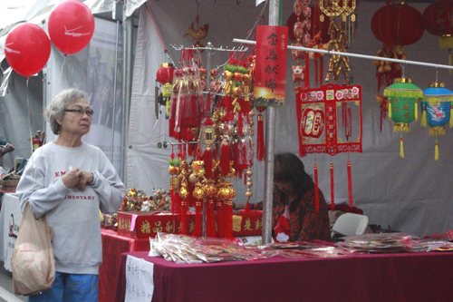 Garvey Street in Monterey Park was closed down to traffic to make room for booths selling traditional Chinese arts and crafts, ornaments, food or providing information. (EGP photo by Nancy Martinez)