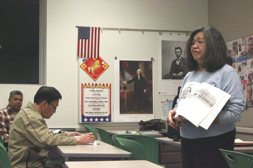 Volunteer Lilian Kawarantani, right, discusses U.S. history with students in her Monday night citizenship class in Monterey Park. (EGP photo by Nancy Martinez)