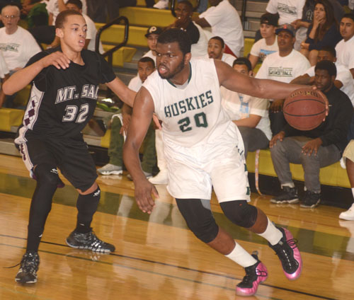 ELAC forward Aaron Cheatum (20) drives the baseline in last Friday's conference-title clinching victory over Mt. San Antonio College.  (Photo by Mario Villegas)