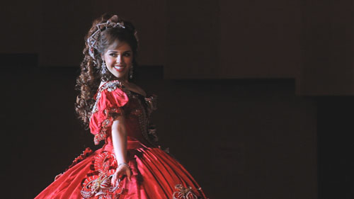 Debutante Laura Garza Hovel pictured in her elaborate gown,  stars in a PBS documentary that follows young Mexican-American woman during a month-long colonial reenactment and celebration in Laredo, Texas. (Photo by Edwin Martinez)