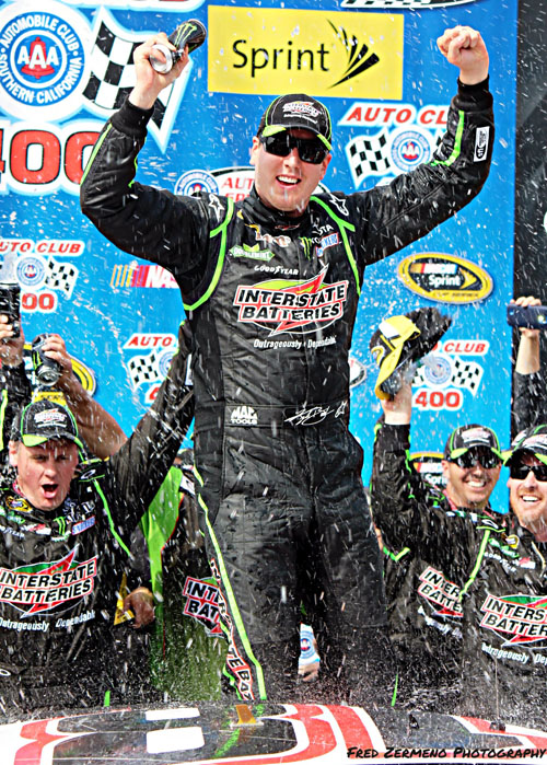 Kyle Busch celebrates his career 29th victory last weekend in Lancaster at the 18th Annual Auto Club 400 at the Auto Club Speedway in Lancaster. The race included 35 lead changes, breaking the previous track record of 33 set back in 2008. Busch's win makes it two in a row after winning the race in 2013 as well. Competition is running high, with a different driver capturing each of the first five races of the season. (EGP Photo by Fred Zermeno)
