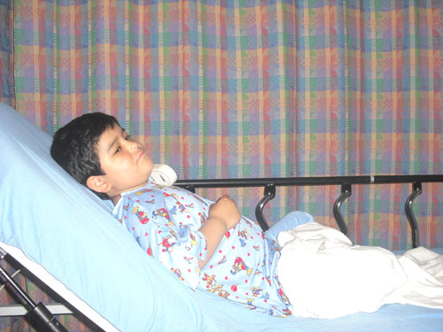 Juanito waits for spinal tap at Children Hospital Los Angeles as part of Leukemia treatment.  (Photo Courtey of Gloria Moreno)