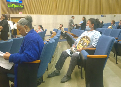 Boyle Heights resident Dolores Mejia, pictured, dresses up as a sick patient to speak at the Los Angeles County Board of Supervisors Meeting  , where a task force dedicated to closing down Exide Technologies in Vernon was approved.  (EGP photo by Nancy Martinez)