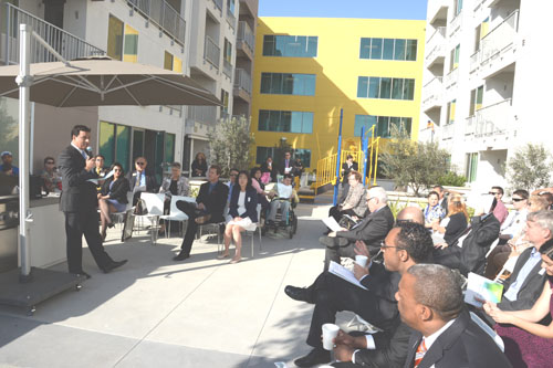 Councilmember Huizar, addresses those assembled for the Grand Opening ceremony for the Whittier Apartments in Boyle Heights.  (Courtesy of Betsy Annas, City of Los Angeles)