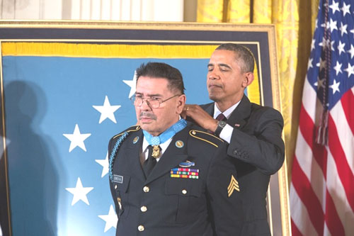 President Barack Obama presents the Medal of Honor to Specialist Four Santiago J. Erevia during the Medal of Honor ceremony in the East Room of the White House, Wednesday. (Official White House Photo by  Amanda Lucidon)