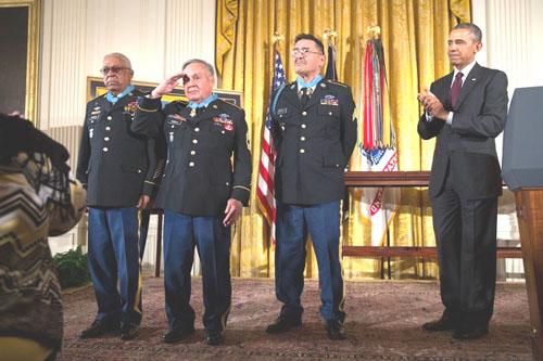 President Barack Obama recognizes Medal of Honor honorees, from left, Staff Sergeant Melvin Morris, Sergeant First Class Jose Rodela, and Specialist Four Santiago J. Erevia, during the Medal of Honor ceremony in the East Room of the White House, Wednesday.  (Official White House Photo by Pete Souza)