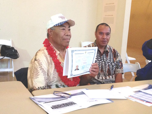 Sione Vanisi became a U.S. citizen at the age of 71 on Wednesday March 19, 2014, he holds his naturalization certificate and says he is happy to be a new citizen. (EGP photo by Jacqueline García)