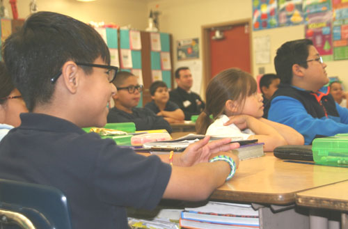 Students at Brooklyn Elementary School in Boyle Heights, listened to volunteers read stories to them as part of the Read Across America campaign. (EGP photo by Jacqueline García)