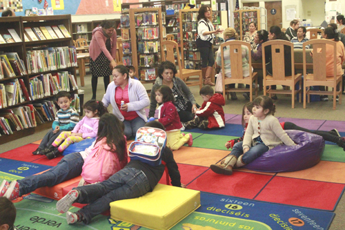 Children enjoy story time at the Bell Gardens library while their mothers and grandmothers attend a speech development workshop a few feet a way. (EGP photo by Nancy Martinez)