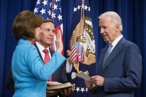 Vice President Joe Biden ceremonially swears in Small Business Administrator Maria Contreras-Sweet, with her husband Ray Sweet holding the bible, in the South Court Auditorium of the White House, April 7, 2014. (Official White House Photo by David Lienemann)