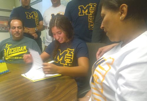 Montebello High School senior Laura Jimenez, center, signs her letter of intent to play water polo at the University of Michigan. (EGP photo by Nancy Martinez)