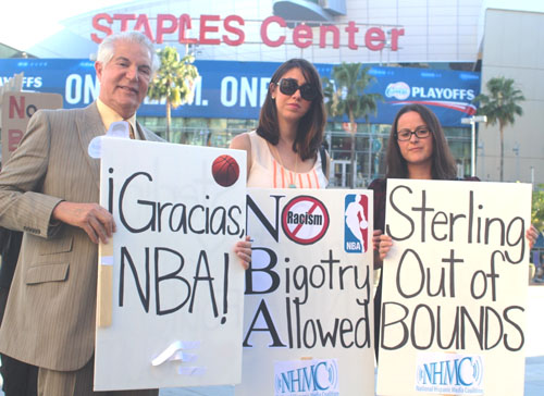 Alex Nogales, left, and his colleagues from the National Hispanic Media Coalition demonstrated support to the NBA's decision to ban Clipper Owner Donald Sterling for life.  (EGP photo by Fred Zermeno)