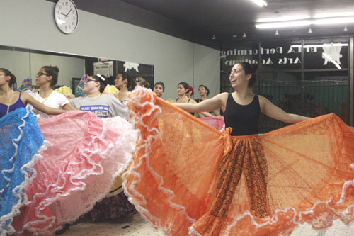 Kareli Montoya, right, founder of Ballet Folklórico de Los Angeles, goes over choreography with her dance group at the Alhambra dance studio.  (EGP photo by Nancy Martinez)