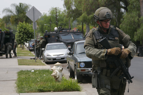A sheriff's SWAT officer at the scene of a barricade in Highland Park on Monday. (Photo by Nancy Martinez )